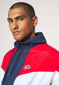 Nike Sportswear - Windbreaker - midnight navy/university red/white - 3