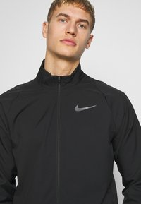 Nike Performance - DRY TEAM - Giacca sportiva - black/black - 3