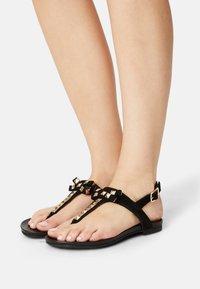 Copenhagen Shoes - MAY - T-bar sandals - black - 0