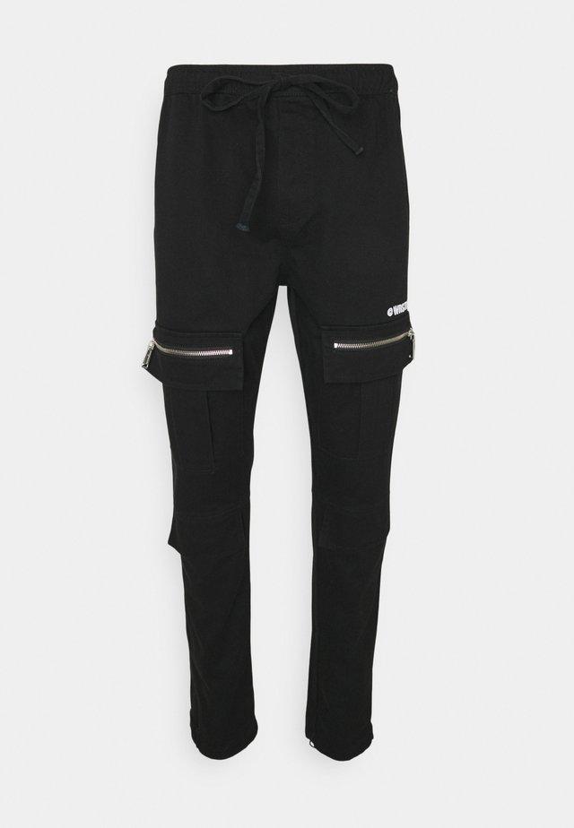 HYBRID PANTS WASHED UNISEX - Trousers - black