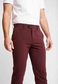 Lindbergh - CLUB PANTS - Trousers - red - 4