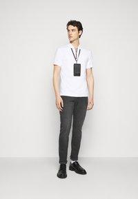 Michael Kors - LOGO ZIP - Polo shirt - white - 1
