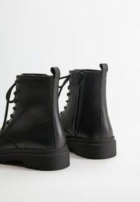 Mango - MARTINA - Lace-up ankle boots - černá - 3