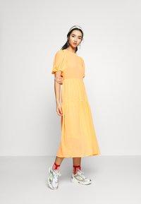 Never Fully Dressed - TIERED SHEER MIDI DRESS - Denní šaty - orange - 1