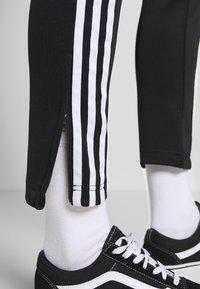 adidas Originals - SUPERSTAR SUPER GIRL ADICOLOR TRACK PANTS - Trainingsbroek - black/white - 3