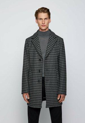 USEV - Short coat - black