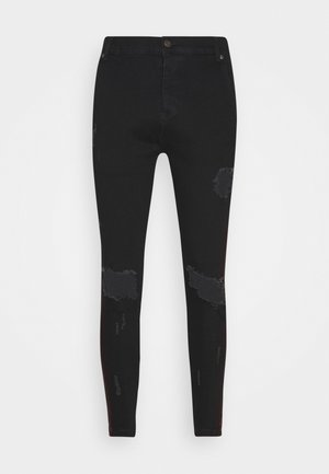 SKINNY FIT PAINT STRIPE WITH DISTRESSING - Skinny džíny - washed black/red