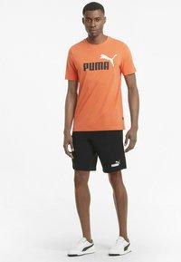 Puma - Sports shorts - puma black - 1