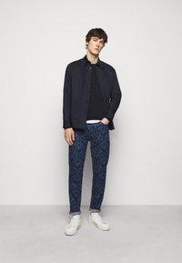 HUGO - Straight leg jeans - dark blue - 1