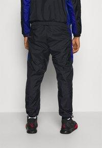 Nike Performance - NBA CITY EDITION TRACKSUIT - Dres - black/rush blue/university red - 4