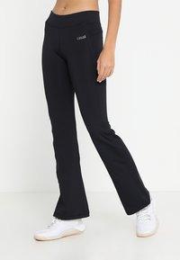 Casall - JAZZPANTS - Spodnie treningowe - black - 0