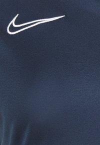 Nike Performance - Print T-shirt - obsidian/white - 7