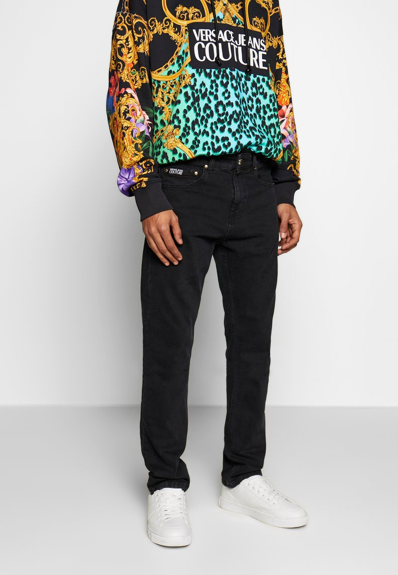Versace Jeans Couture - MILANO JUNGLE BACK POCKET - Slim fit jeans - black