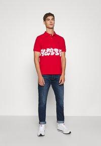 Polo Ralph Lauren - PARKSIDE ACTIVE TAPER STRETCH JEAN - Straight leg jeans - rockton stretch - 1