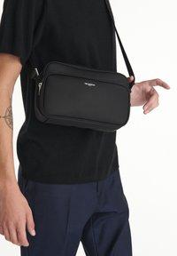 The Kooples - SAC UNISEX - Across body bag - black - 1