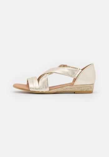HALLIE - Wedge sandals - gold