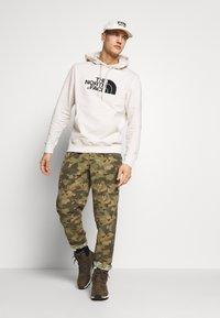 The North Face - CLASS PANT - Stoffhose - burnt olive - 1