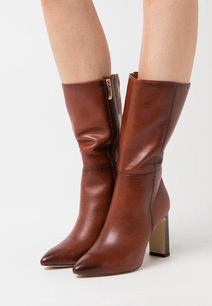 High heeled boots - cinnamon