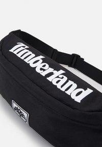Timberland - BUM BAG - Taška spříčným popruhem - black - 4