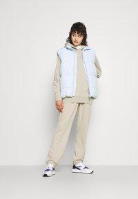 Nike Sportswear - Tracksuit bottoms - beige - 4