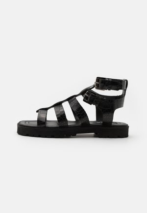 STARK - Sandals - black