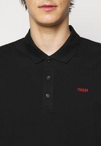 HUGO - DONOS - Polo shirt - black - 4