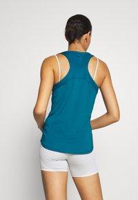 Puma - TRAIN FAVORITE RACERBACK - Camiseta de deporte - digi-blue - 2