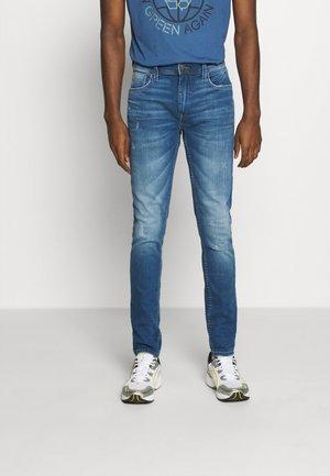 MULTIFLEX - Slim fit jeans - denim middle blue
