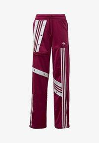 adidas Originals - DANIËLLE CATHARI JOGGERS - Joggebukse - purple - 5
