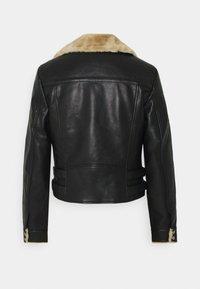Vero Moda Petite - VMELLIEROSA SHORT JACKET - Faux leather jacket - black - 1