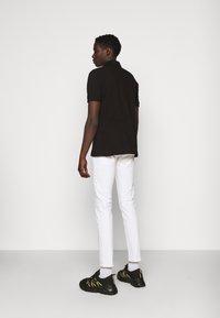 Versace Jeans Couture - PLAIN - Polo shirt - black - 2
