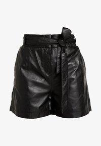 CARMEN - Kožené kalhoty - black