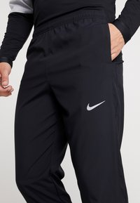 Nike Performance - RUN STRIPE PANT - Träningsbyxor - black/silver - 5