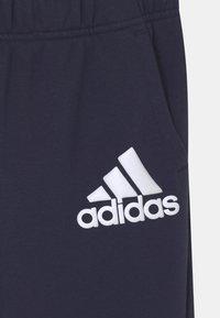 adidas Performance - UNISEX - Tracksuit bottoms - legend ink/white - 2