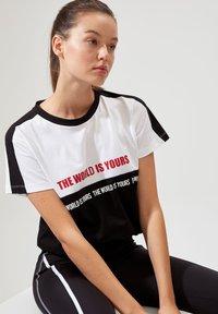 DeFacto - Print T-shirt - black - 0
