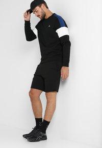 Lacoste Sport - MEN TENNIS SHORT - Sports shorts - black - 1