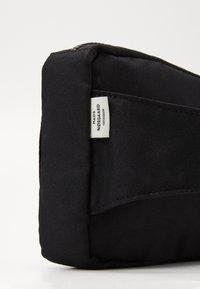 Mads Nørgaard - BEL AIR RECY CARNI UNISEX - Bum bag - black - 2