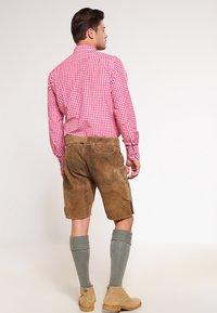 Stockerpoint - CORBI - Leather trousers - havanna - 2