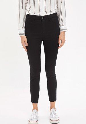 ANNA - Pantaloni - black