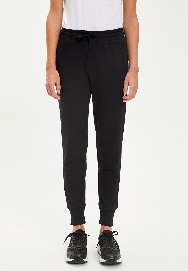 DeFacto - Pantalones deportivos - black