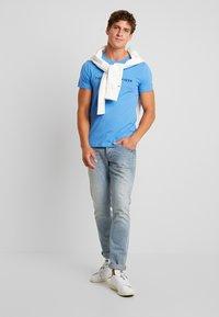 Tommy Hilfiger - LOGO TEE - Print T-shirt - blue - 1