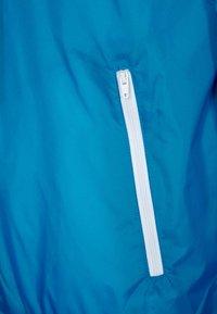 Urban Classics - Light jacket - turquoise/white - 2