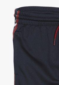 Converse - STAR CHEVRON COLORBLOCK TAPING TRACK PANT - Pantaloni sportivi - obsidian - 2