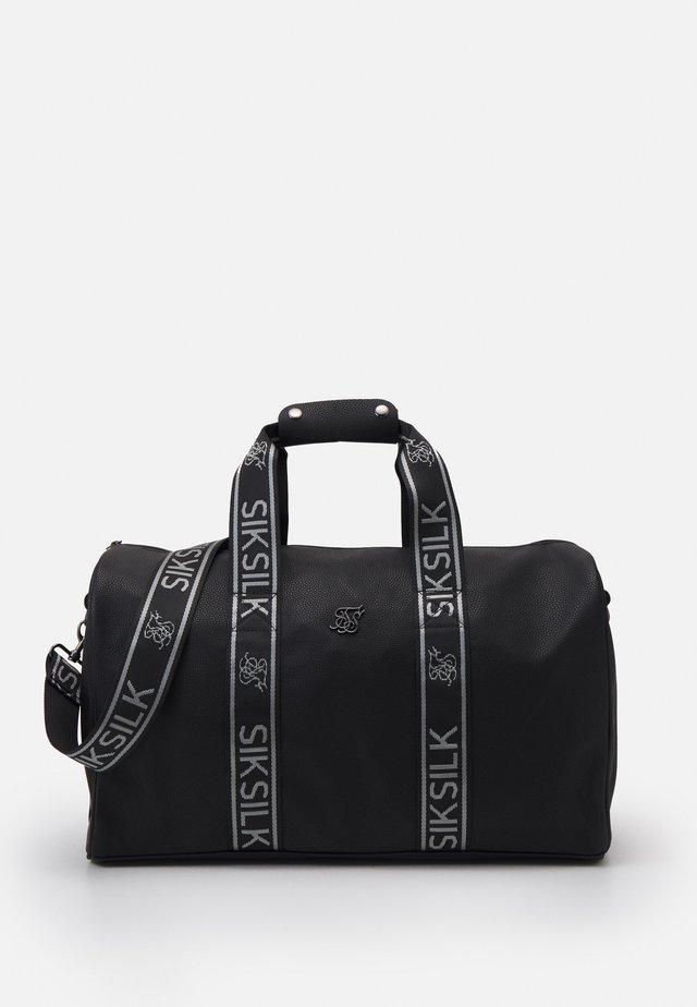 TAPE TRAVEL BAG UNISEX - Sportovní taška - black