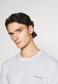 Calvin Klein - LONG SLEEVE LOGO 2 PACK - Top sdlouhým rukávem - black/white - 5