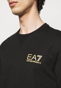 EA7 Emporio Armani - Sweatshirt - black/gold - 4