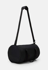 Ellesse - TOFFAN BARREL BAG - Sports bag - black - 1