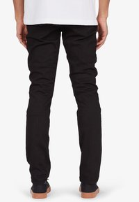 DC Shoes - WORKER - Slim fit jeans - black rinse - 1