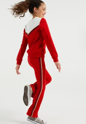 MET GLITTERBIES - Tracksuit bottoms - bright red