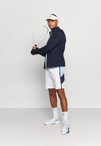 Lacoste Sport - TRACK JACKET - Training jacket - navy blue/white - 1